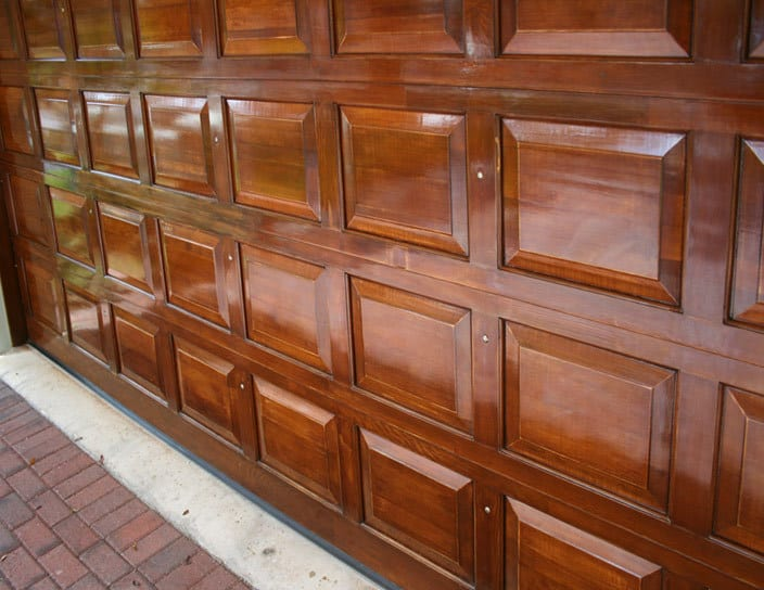 Residential garage doors r s erection of concord for How to stain a wood garage door