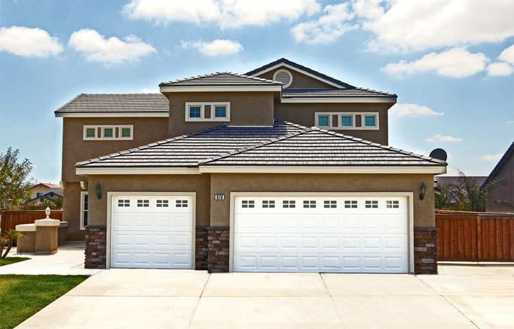 Garage Door Design there is a carriage house door available to match any home design most homeowners we speak with are surprised at how affordable wood garage doors can be Residential Garage Door Brentwood