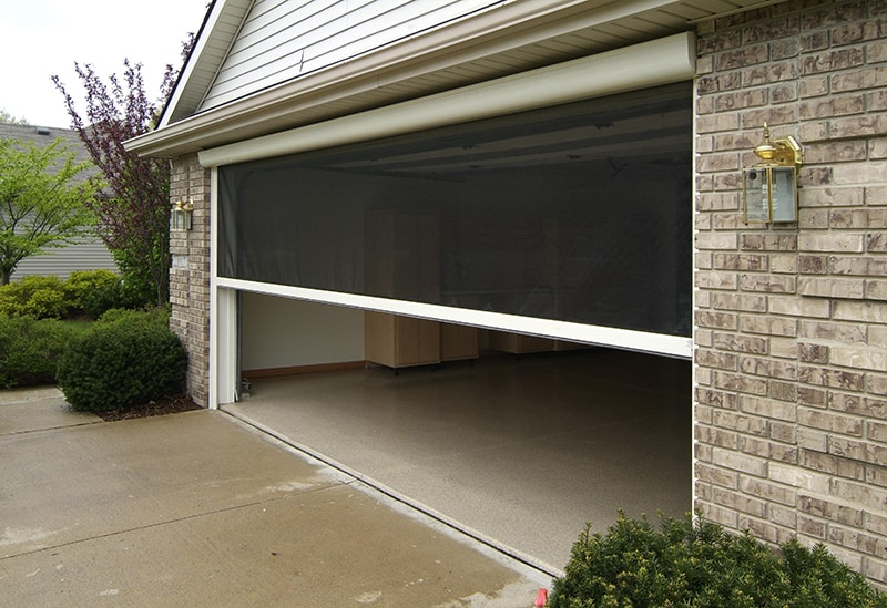 Retractable screen garage door motorized wageuzi for Roll up screen door for garage